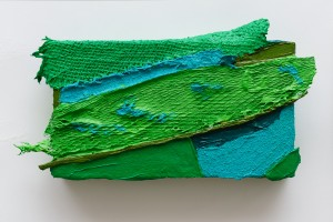 Grow Fins II (2011), Acrylic and Pumice on Sacking, Bird Feeder, Plastic Netting, Boot Lace, Cloth and Canvas, 5 x 9 inches